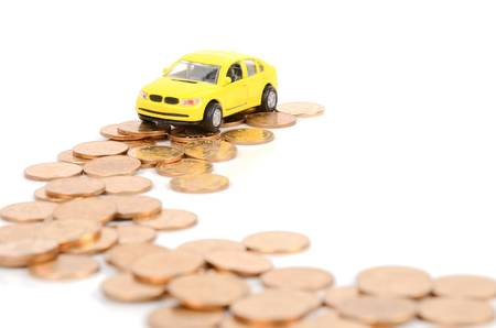 Toy car and coins Stock Photo - 12502027