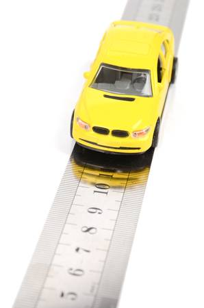rectilinear: Toy car on ruler Stock Photo