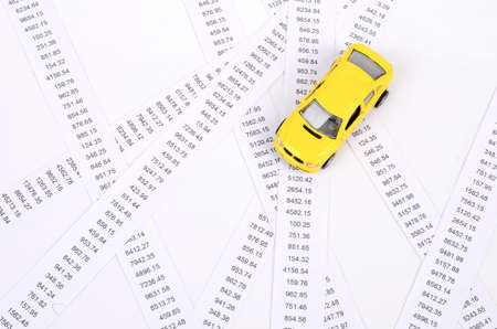 Receipts and toy car photo