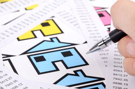 cash register building: Receipts and house with pen Stock Photo