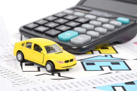 cash register building: Receipts and house with toy car Stock Photo