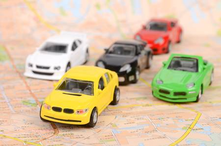 Toy cars on map photo