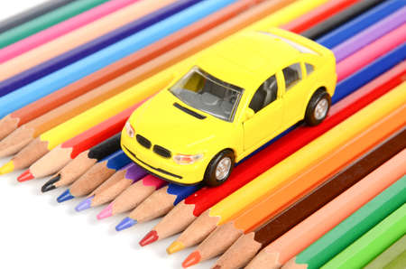 Toy car and color pencil photo
