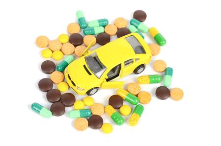 Toy cars and medicine photo