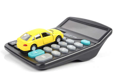Toy car and calculator Stock Photo