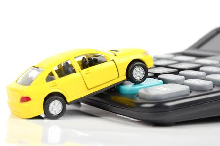 car loans: Toy car and calculator Stock Photo