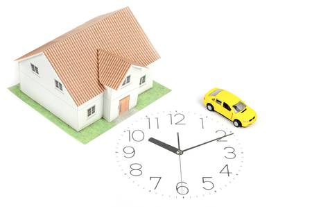 Toy car and house on clock face photo