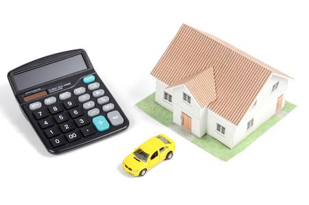 Toy car and house with calculator Stock Photo - 12544527