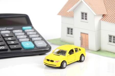Toy car and house with calculator Stock Photo - 12544576