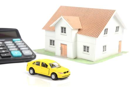 Toy car and house with calculator photo