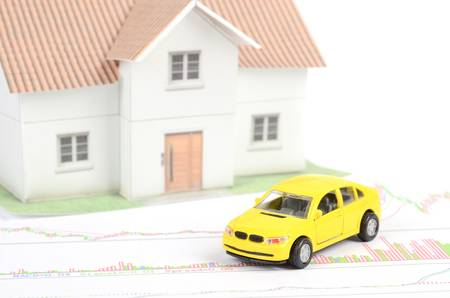 Toy car and house photo
