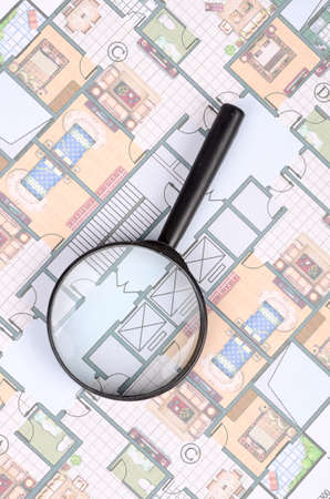 prefabricated: Magnifier glass and blueprint