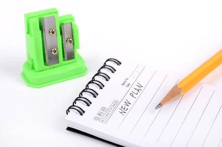 Pencil,sharpener and notepad photo