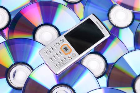 conputer: Mobile phone and DVD Stock Photo