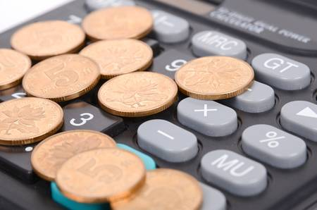 Coin and calculator photo