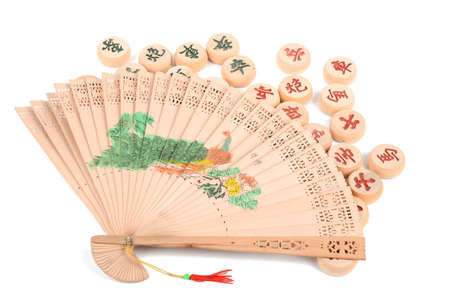 Chinese chess and hand fan Stock Photo - 12789555