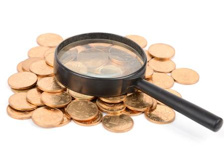 Magnifier and coins photo