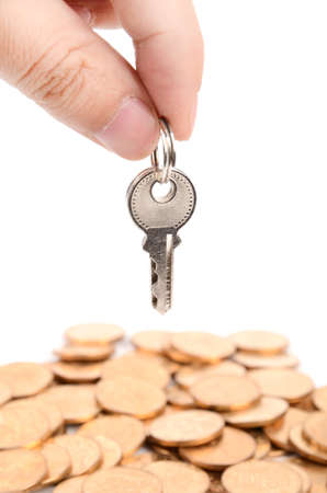 Coin and key Stock Photo - 12820934