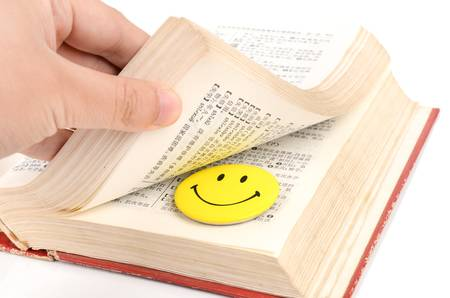 Smile face and book