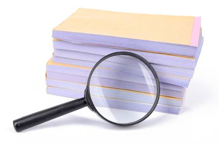 Notebook and magnifier Stock Photo - 12874140