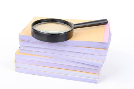 Notebook and magnifier Stock Photo - 12874186