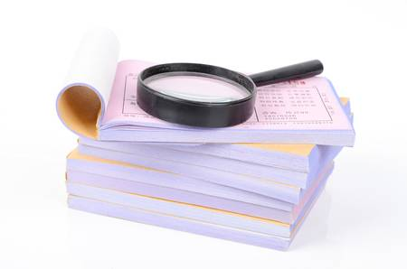 Notebook and magnifier Stock Photo - 12877137