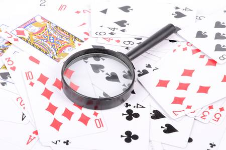 Magnifier and poker Stock Photo - 12874407