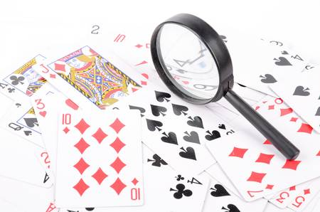 Magnifier and poker Stock Photo - 12874646