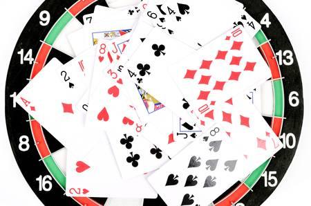 Poker on dartboard photo