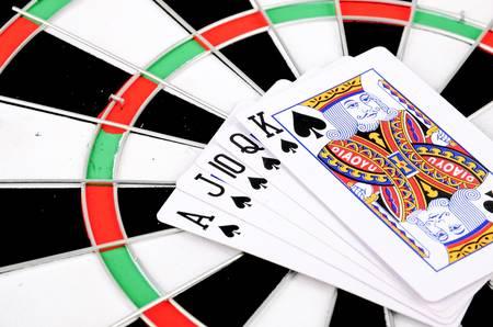 dartboard: Poker on dartboard Stock Photo