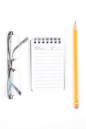 Notebook and pen with glasses photo