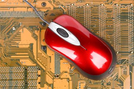 mainboard: Computer mainboard and mouse Stock Photo