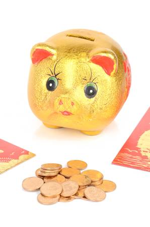 Piggy bank and red packet with coins photo