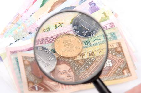 Magnifier and chinese currency photo