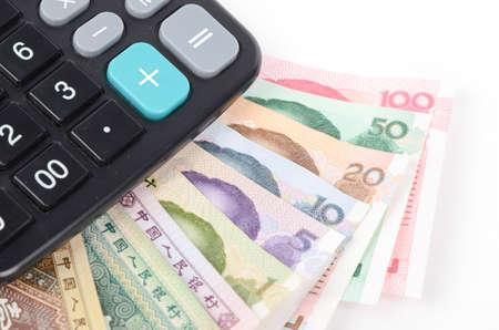 calculator chinese: Calculator and chinese currency Stock Photo