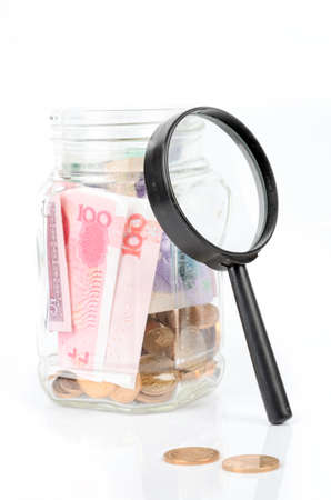 Chinese currency and magnifier photo