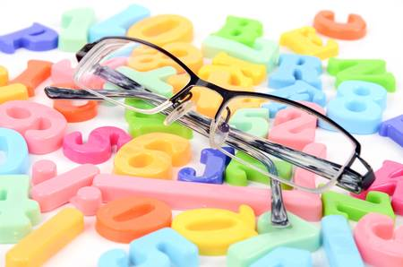 Eyeglasses and letters photo