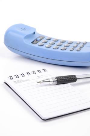 rang: Notepad and phone