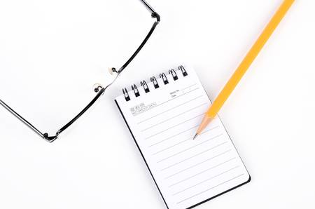 Glasses and pencil with notepad Stock Photo - 12974856