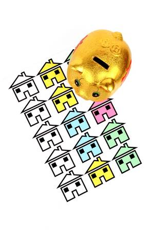 Piggy bank and house Stock Photo - 12974588