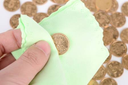 Cleaning coins photo