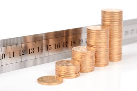 Coins and ruler Stock Photo