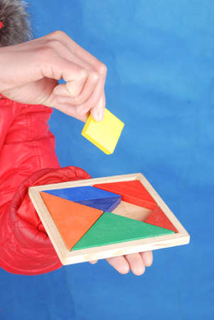 color tangram: Chinese puzzle in hand Stock Photo