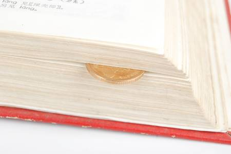 Dictionary and coin photo