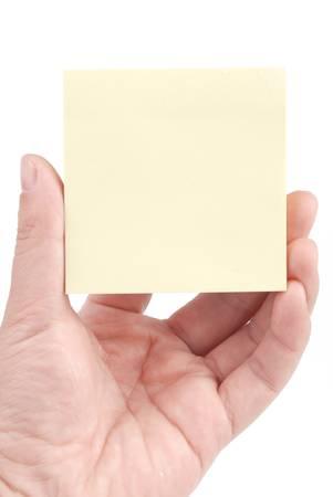 Hand holding sticky note