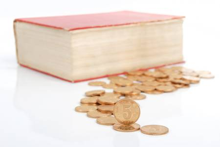 Coins and dictionary Stock Photo - 13138996