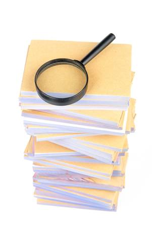 Documents and magnifier Stock Photo - 13137402