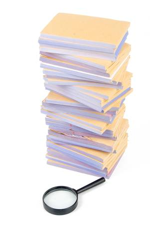 Documents and magnifier Stock Photo - 13137395