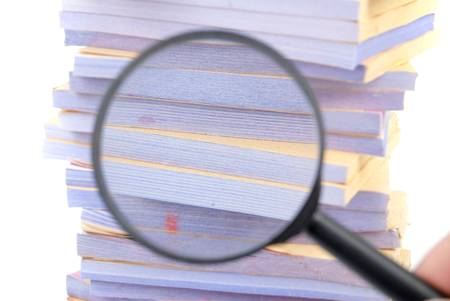 Documents and magnifier Stock Photo - 13137396