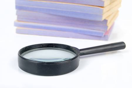 Documents and magnifier Stock Photo - 13137410